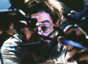 John Cusack in una sequenza di Essere John Malkovich