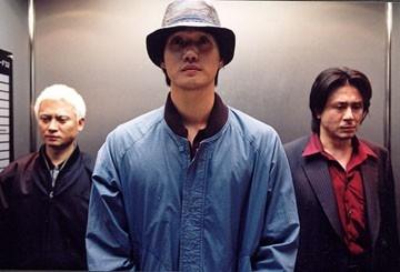 Byeong-ok Kim, Ji-tae Yu e Choi Min-Sik in una scena di Old Boy