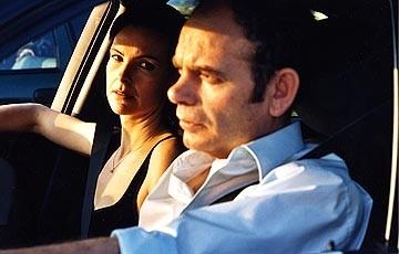 Carole Bouquet e Jean-Pierre Darroussin in una scena di Luci nella notte