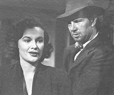 Doll (Jean Hagen) prega Dix (Sterling Hayden) di scappare insieme a lei