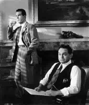 Fred MacMurray ed Edward G. Robinson in una scena di LA FIAMMA DEL PECCATO