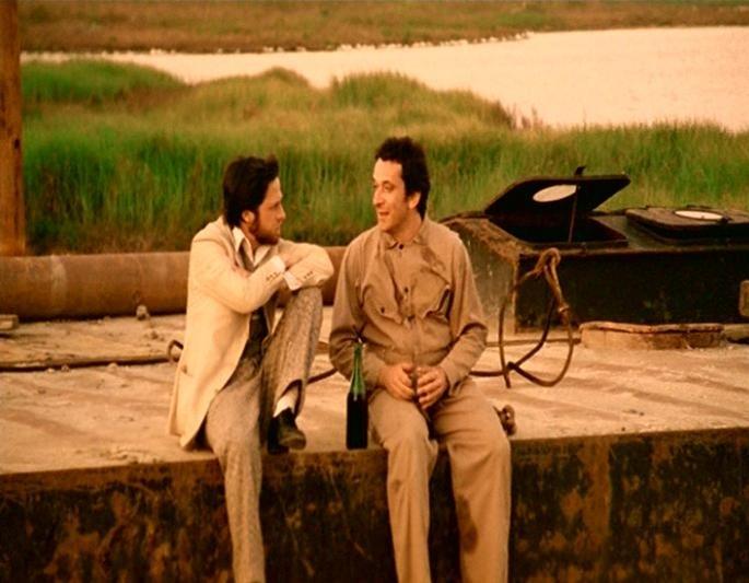 Lino Capolicchio e Gianni Cavina in una scena de LA CASA DALLE FINESTRE CHE RIDONO