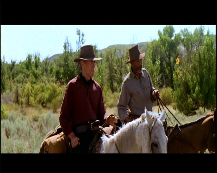 Clint Eastwood e Morgan Freeman in una scena de GLI SPIETATI