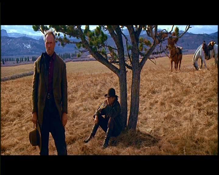 Clint Eastwood e Richard Harris in una scena de GLI SPIETATI