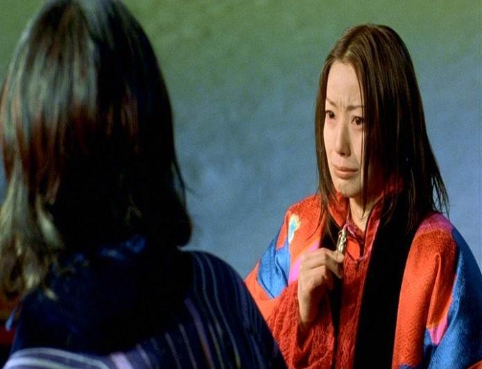 Hidetoshi Nishijima e Miho Kanno in una scena di DOLLS
