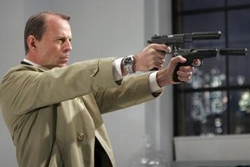 Bruce Willis in una sequenza di Slevin - Patto criminale