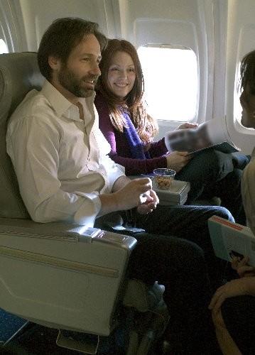 Julianne Moore accanto a David Duchovny in una scena del film film Uomini & donne - Tutti dovrebbero venire... almeno una volta