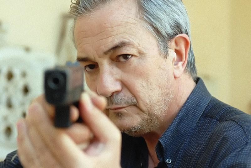 Remo Girone in una scena del film Morte di un confidente