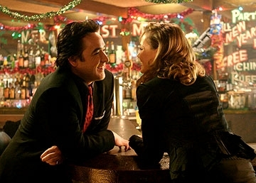 Connie Nielsen con John Cusack in una scena del film The Ice Harvest