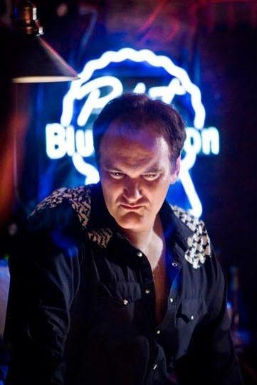 Il regista Quentin Tarantino in una scena del film Death Proof, episodio del double feature Grind House