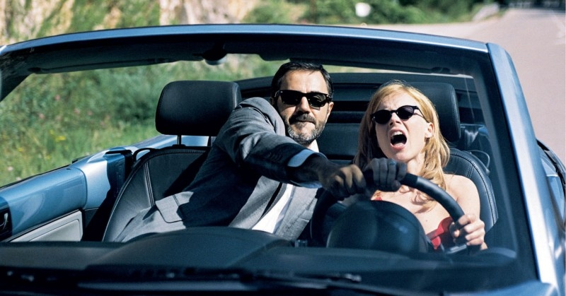 Isabelle Carré e José Garcia in una scena divertente di Hotel a cinque stelle