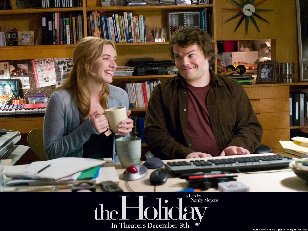 Jack Black e Kate Winslet in un wallpaper del film L'amore non va in vacanza