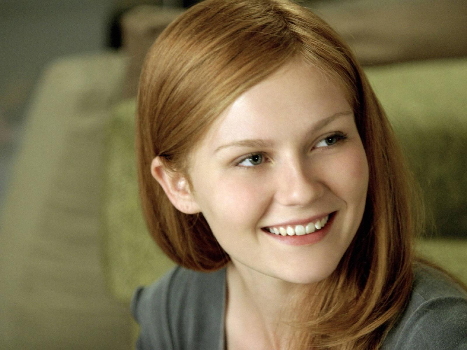 Wallpaper di Kirsten Dunst con i capelli rossi