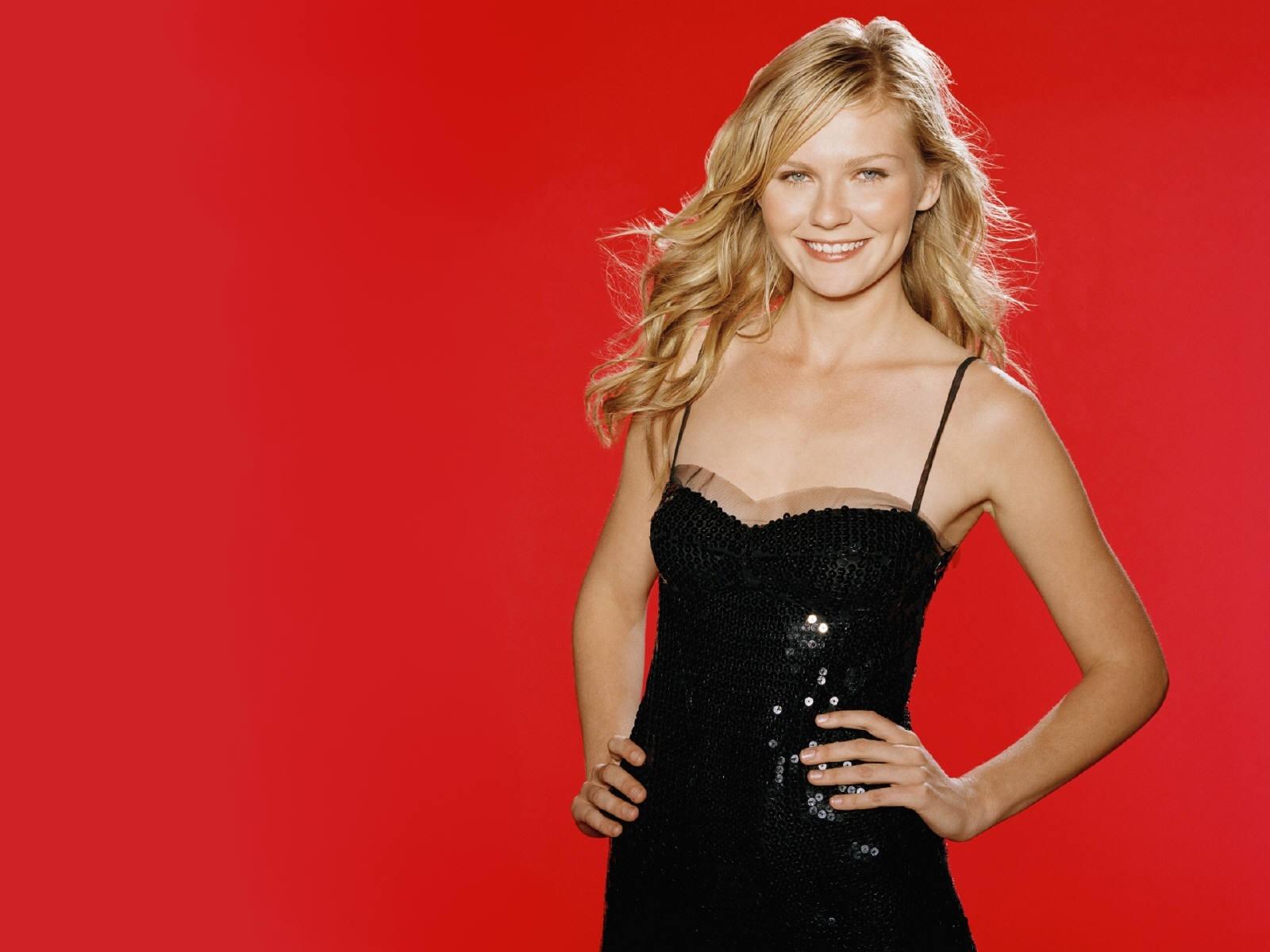 Wallpaper di Kirsten Dunst su sfondo rosso
