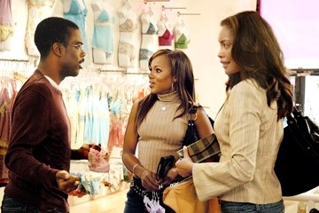 Chris Rock, Gina Torres e Kerry Washington in una scena del film Manuale d'infedeltà per uomini sposati