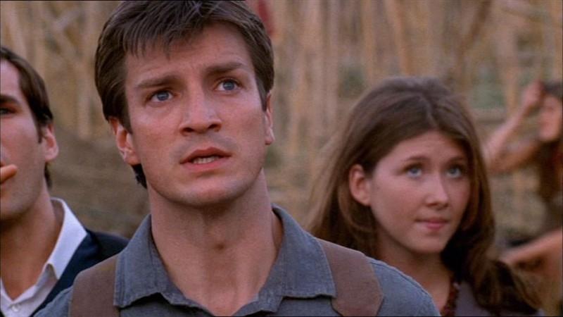 Jewel Staite e Nathan Fillion in una scena di Firefly, episodio La città di Jayne