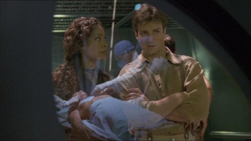Nathan Fillion e Gina Torres in una scena di Firefly, episodio Frontiere selvagge