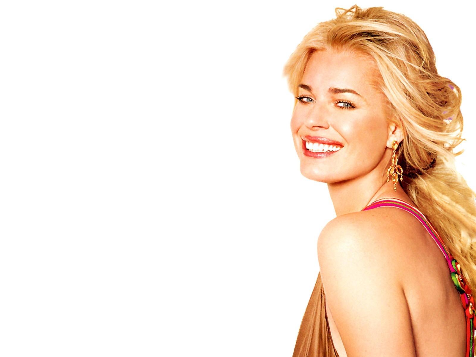 Wallpaper: un sorriso seducente per Rebecca Romijn