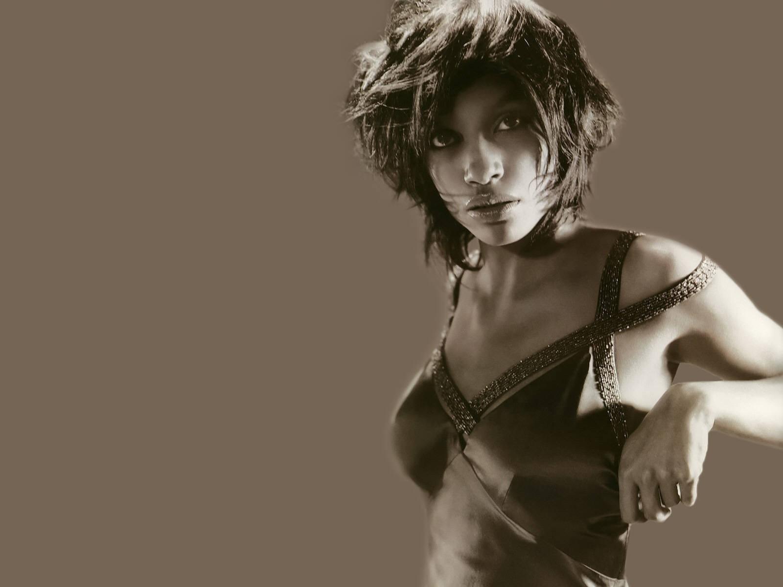 Wallpaper - fascino in bianco e nero per Rosario Dawson