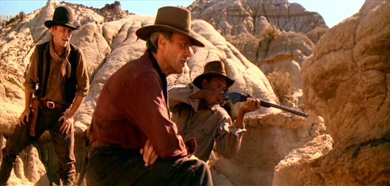 Jaimz Woolvett, Clint Eastwood e Morgan Freeman in una scena de GLI SPIETATI