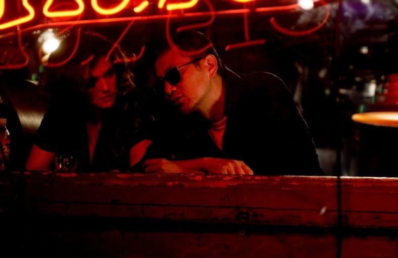 Wogn Kar-Wai e Norah Jones sul set del film Un bacio romantico