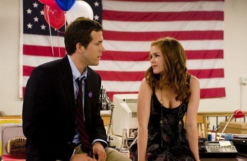 Ryan Reynolds con Isla Fisher in una scena di Certamente, forse