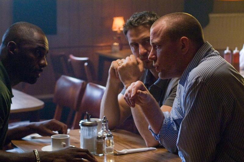 Idris Elba, Gerard Butler e il regista Guy Ritchie sul set del film RocknRolla
