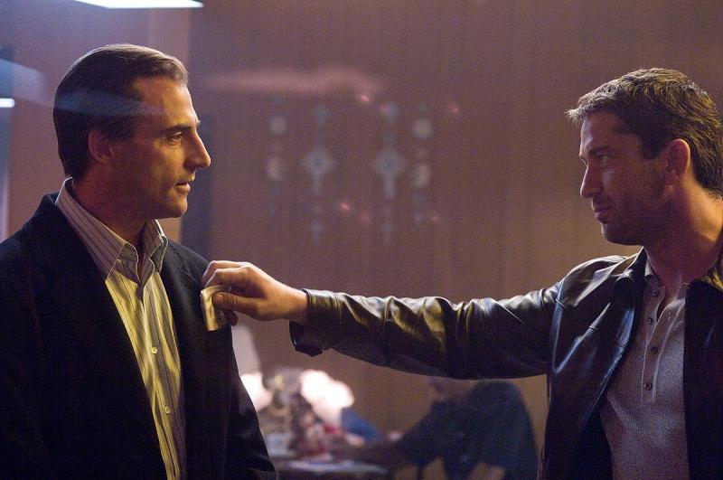 Mark Strong e Gerard Butler in una scena del film RocknRolla
