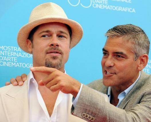 65esima Mostra del Cinema di Venezia: Clooney e Pitt durante la presentazione di 'Burn After Reading - A prova di spia' dei fratelli Coen