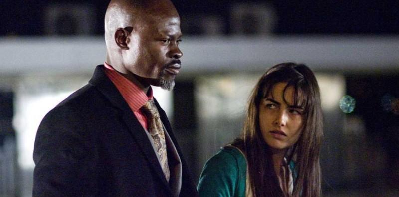 Djimon Hounsou e Camilla Belle in una scena del film Push