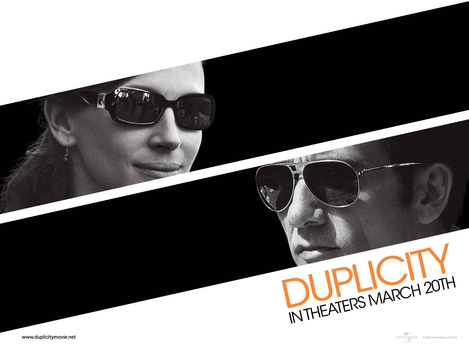 Un wallpaper del film Duplicity con Julia Roberts e Clive Owen