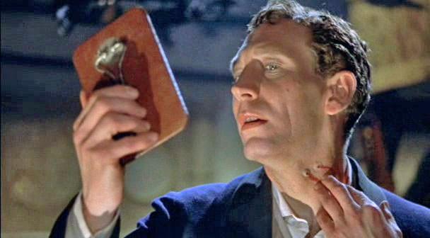 John Van Eyssen in una scena di Dracula il vampiro