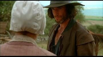 Daniel Day-Lewis e Winona Ryder in una scena del film La seduzione del male