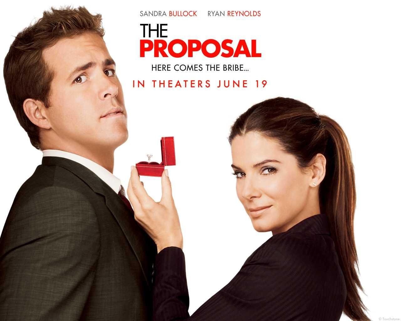 Un wallpaper della commedia Ricatto d'amore con Ryan Reynolds e Sandra Bullock