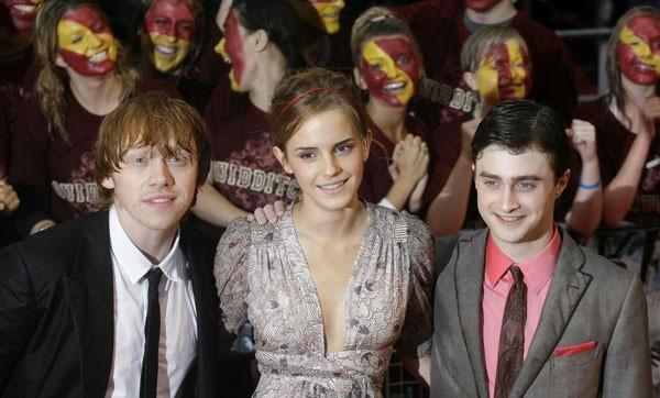 Emma Watson, Rupert Grint e Daniel Radcliffe durante la premiere 'bagnata' di Harry Potter e il Principe Mezzosangue