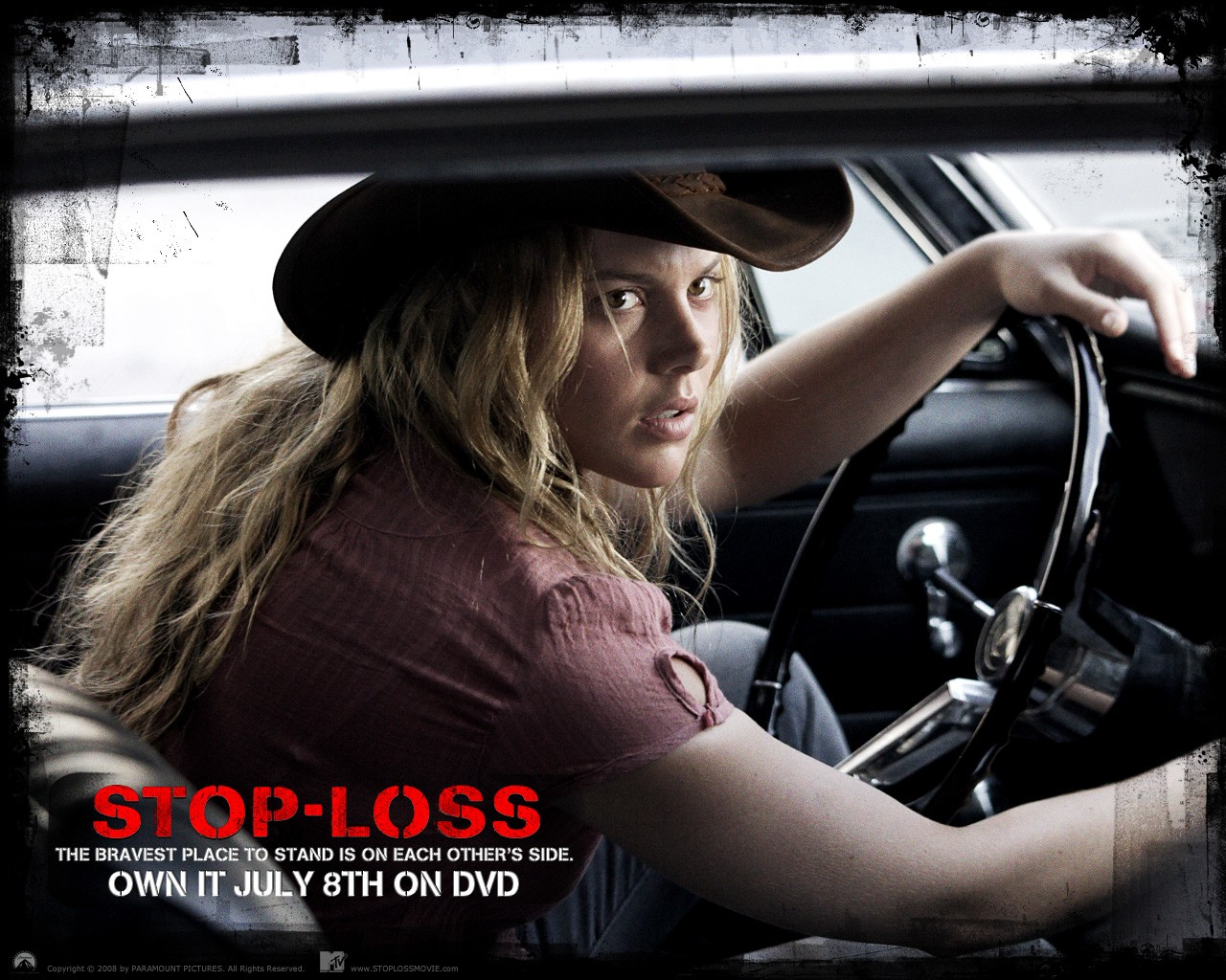 Un wallpaper ufficiale del film Stop Loss, con Abbie Cornish
