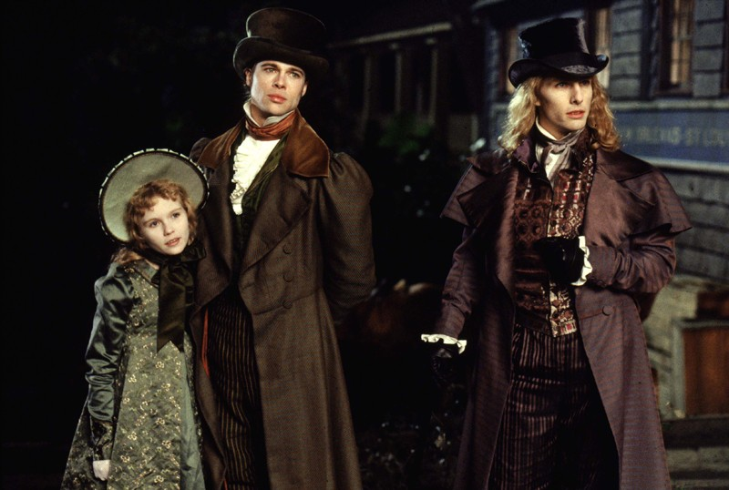 Claudia (Kirsten Dunst), Louis (Brad Pitt) e Lestat (Tom Cruise) in una scena del film Interview with the Vampire