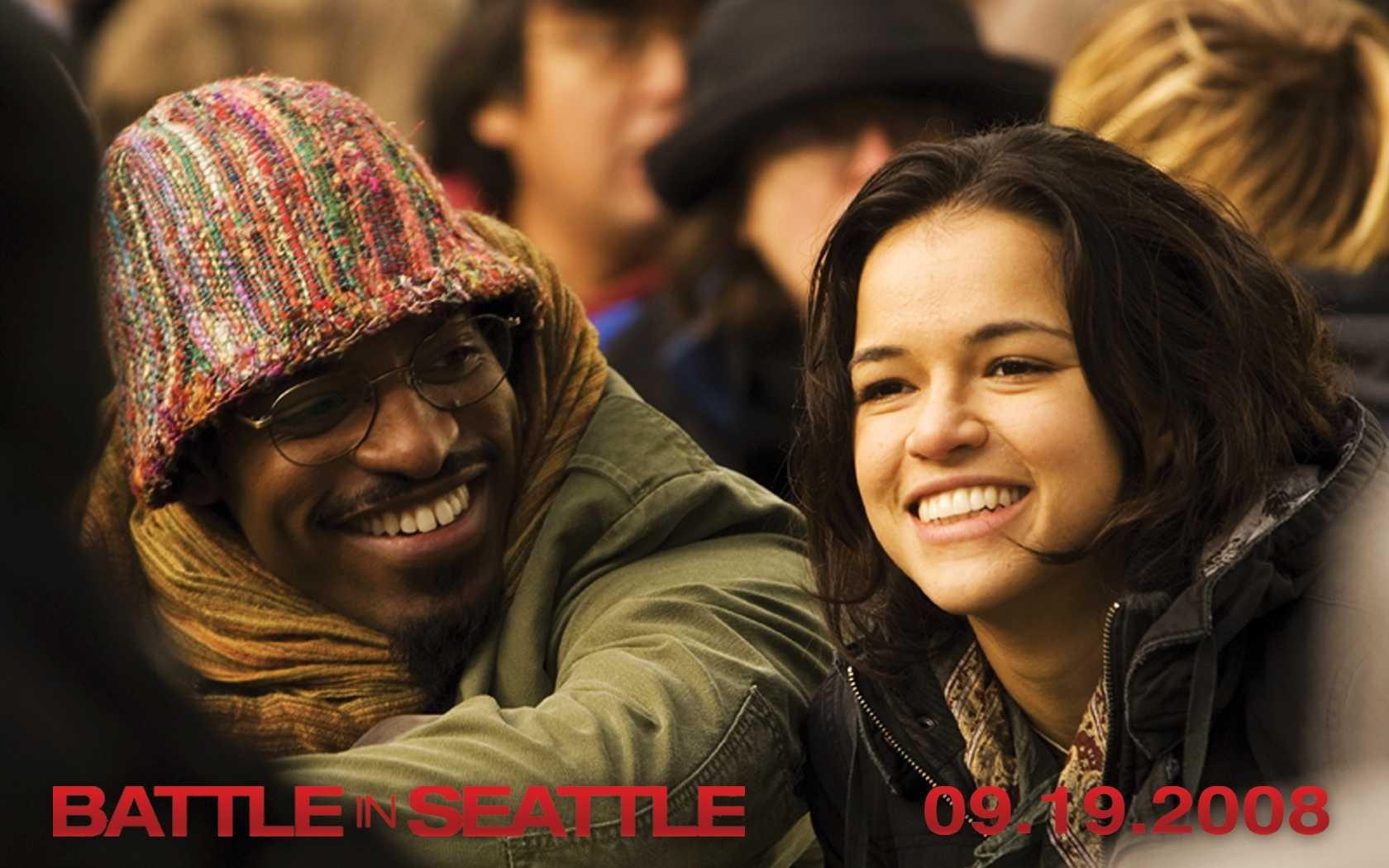 Wallpaper del film Battle in Seattle, con André Benjamin e Michelle Rodriguez