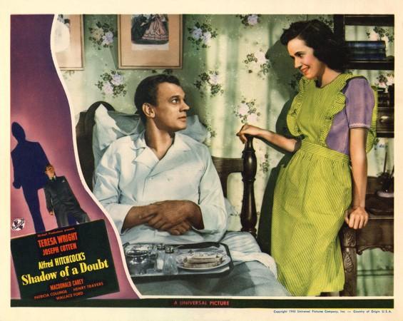 Joseph Cotten e Teresa Wright in una coloratissima lobbycard promozionale del film L\'ombra del dubbio ( 1943 )