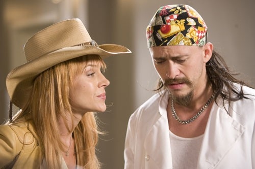 Julie Benz e Clifton Collins Jr. in una scena del film The Boondock Saints II: All Saints Day