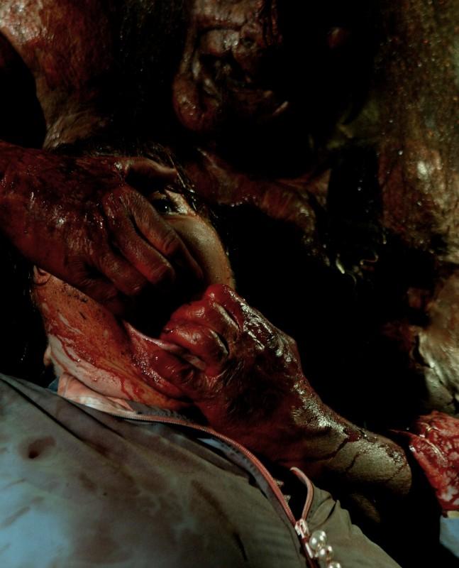 Joel Murray irriconoscibile in una scena dell'horror Hatchet