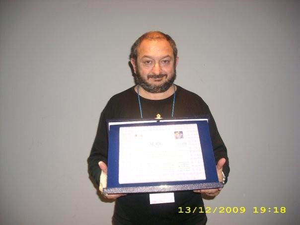 Orfeo Orlando con il premio ricevuto per il film The Real life al Pistoia Corto Film Festival 2009