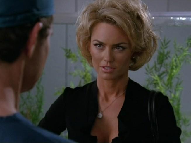 Nip/Tuck: Dylan Walsh (di spalle) e Kelly Carlson in una scena dell'episodio Dan Daly