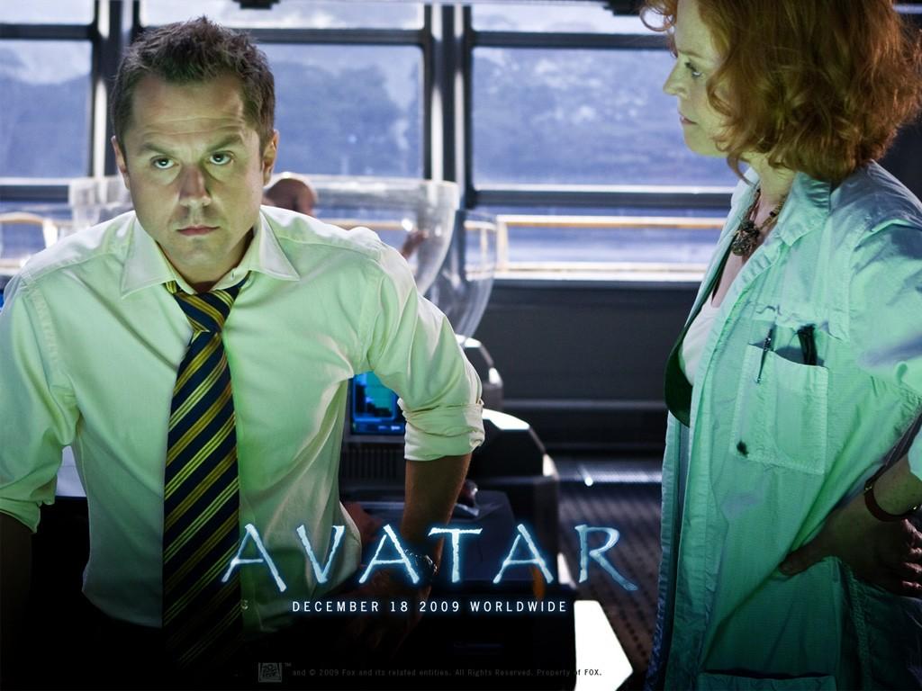 Un wallpaper ufficiale con Giovanni Ribisi e Sigourney Weaver nel film Avatar