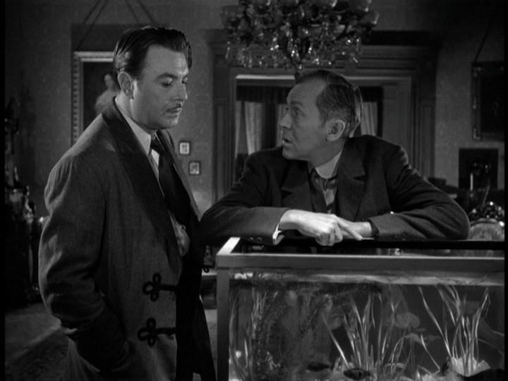 George Brent e James Bell in una scena del film La scala a chiocciola (1946)