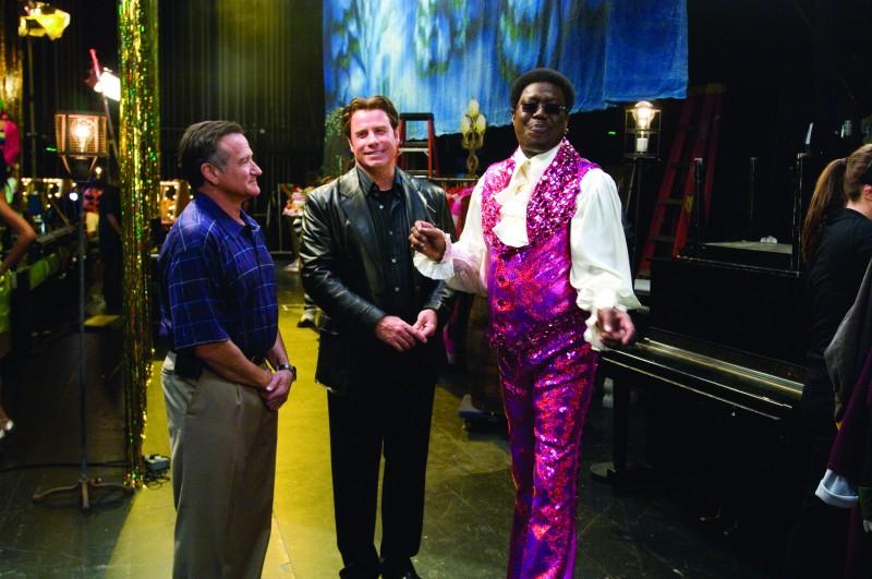 Robin Williams, John Travolta e Bernie Mac in una divertente immagine tratta dal film Daddy Sitter
