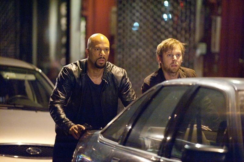 I pericolosi Collins (Common) e Armstrong (Jimmi Simpson) in una sequenza del film Date Night