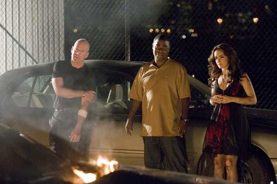 Tracy Morgan, Bruce Willis e Michelle Trachtenberg in una scena di Cop Out