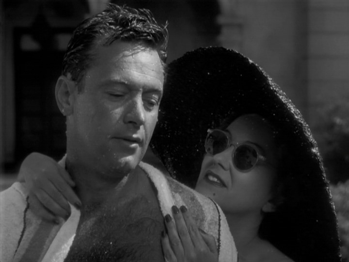 William Holden e Gloria Swanson in una scena del film Viale del tramonto del 1950
