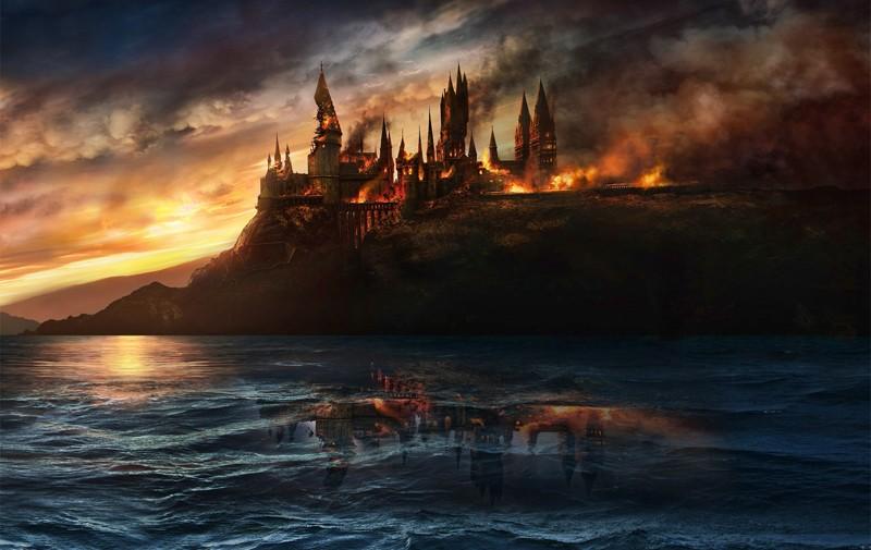 Un'immagine promozionale del castello di Hogwarts in fiamme per il film I Doni della Morte - parte 1